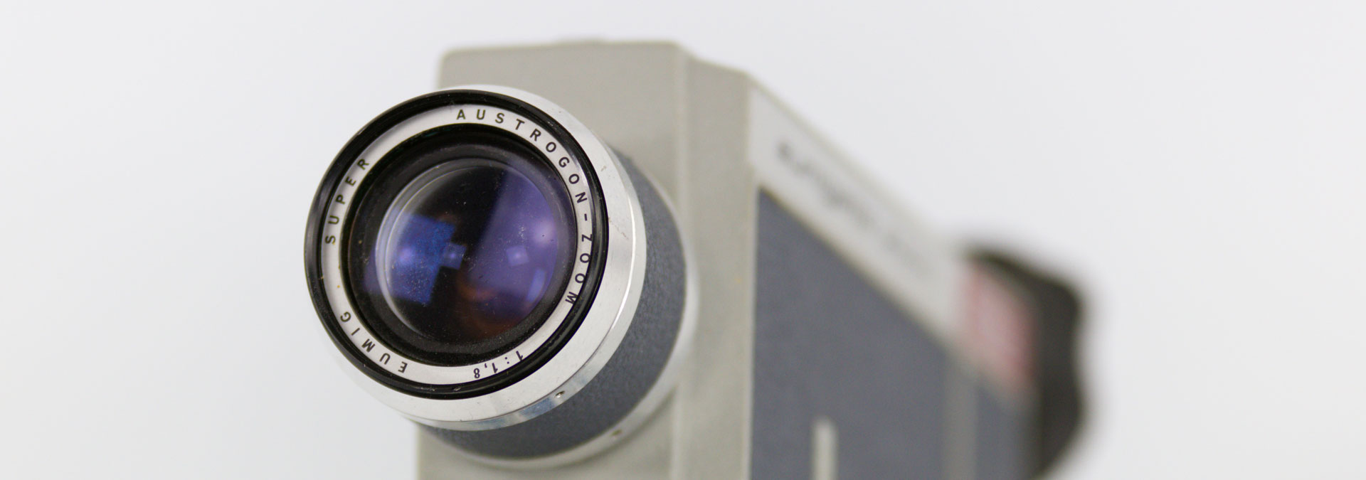 Old analogue video camera showing lens
